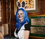 waitress with blue hair and cat costume